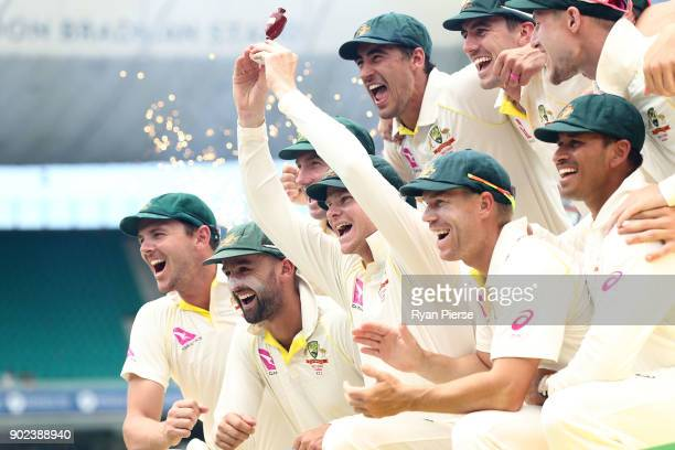 Steve Smith of Australia lifts the Ashes Urn during day five of the Fifth Test match in the 2017/18 Ashes Series between Australia and England at...