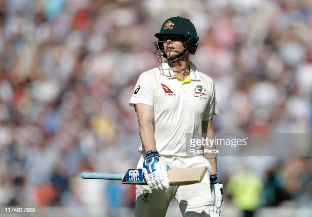Steve Smith of Australia looks dejected after being dismissed by Stuart Broad of England during day four of the 5th Specsavers Ashes Test between...
