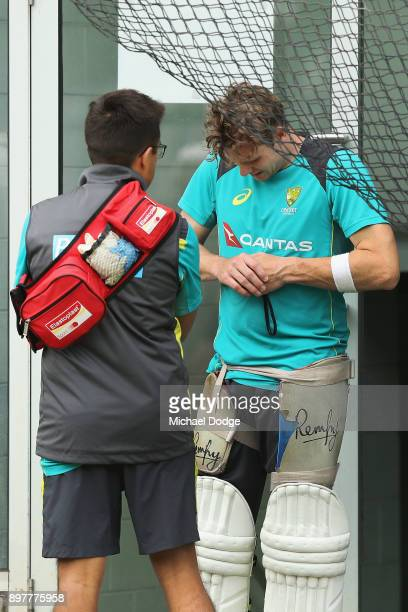 Steve Smith of Australia looks in discomfort after copping a freakish knock to his wrist while sitting in the nets after Cameron Bancroft the ball...