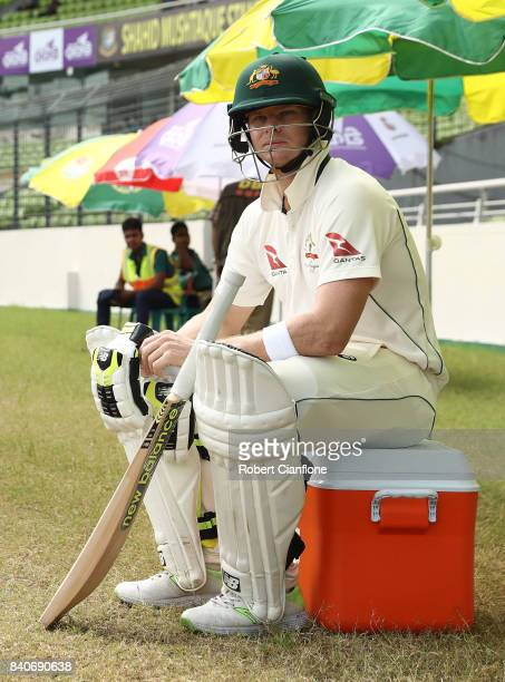 Steve Smith of Australia looks on as he waits to bat during day four of the First Test match between Bangladesh and Australia at Shere Bangla...
