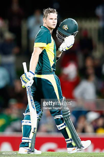 Steve Smith of Australia looks to his team mates after scoring 100 runs during the One Day International Tri Series match between Australia and...