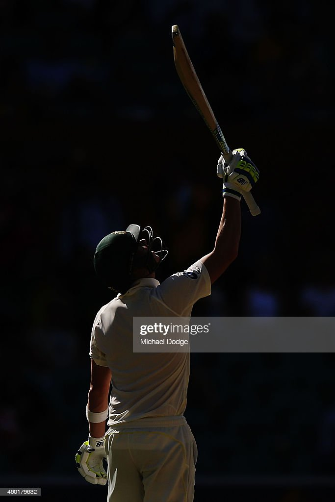 Steve Smith of Australia looks up to the sky in tribute to the late Phillip Hughes after his half century during day one of the First Test match between Australia and India at Adelaide Oval on December 9, 2014 in Adelaide, Australia.