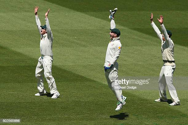 Steve Smith of Australia Peter Nevill and Adam Voges appeal unsuccessfully for an LBW against Rajendra Chandrika of the West Indies during day two of...