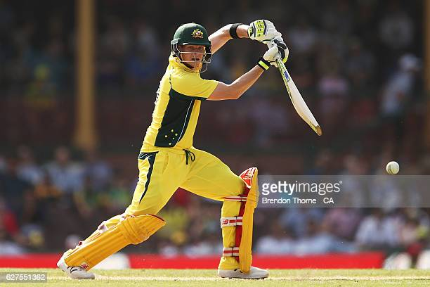 Steve Smith of Australia plays a cover drive during game one of the One Day International series between Australia and New Zealand at Sydney Cricket...