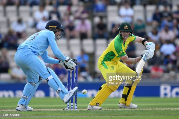 Steve Smith of Australia plays a shot as England wicketkeeper Jos Buttler looks on during the ICC Cricket World Cup 2019 Warm Up match between...