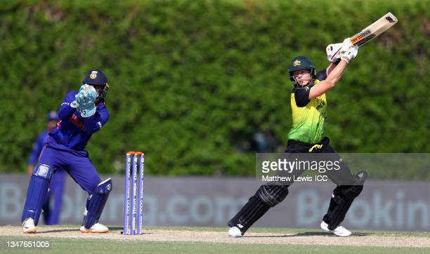Steve Smith of Australia plays a shot as Ishan Kishan of India looks on during the India and Australia warm Up Match prior to the ICC Men's T20 World...