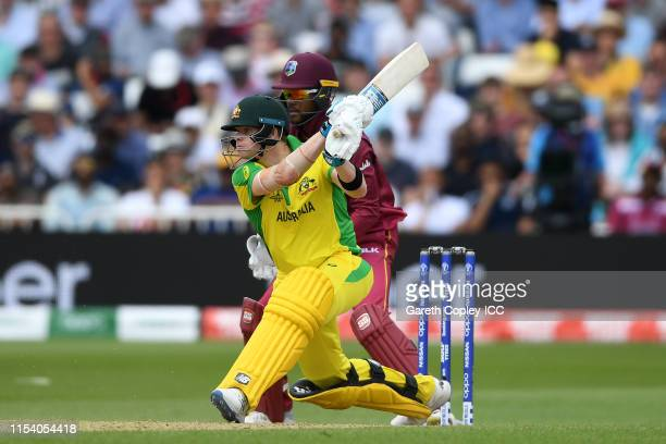Steve Smith of Australia plays a shot as Shai Hope of West Indies looks on during the Group Stage match of the ICC Cricket World Cup 2019 between...