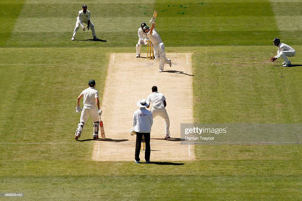 Steve Smith of Australia plays a straight drive during day one of the Third Test match between Australia and India at Melbourne Cricket Ground on December 26, 2014 in Melbourne, Australia.