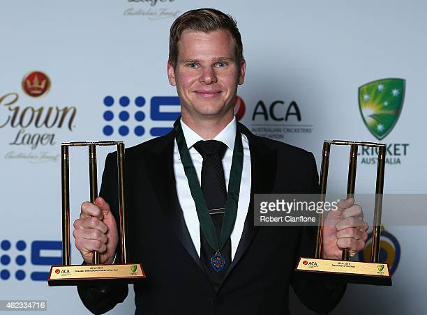 Steve Smith of Australia poses with the Allan Border Medal ODI Player of the Year and Test Player of the Year Awards during the 2015 Allan Border...