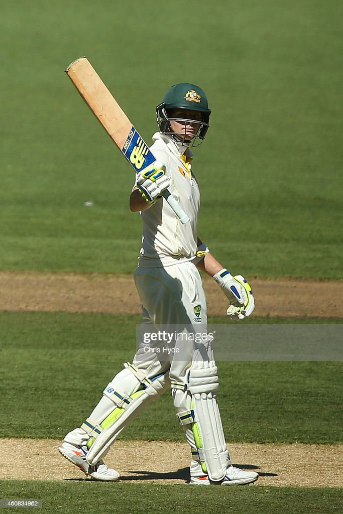Steve Smith of Australia raises his bat after reaching 50 runs during day one of the Third Test match between Australia and India at Melbourne Cricket Ground on December 26, 2014 in Melbourne, Australia.