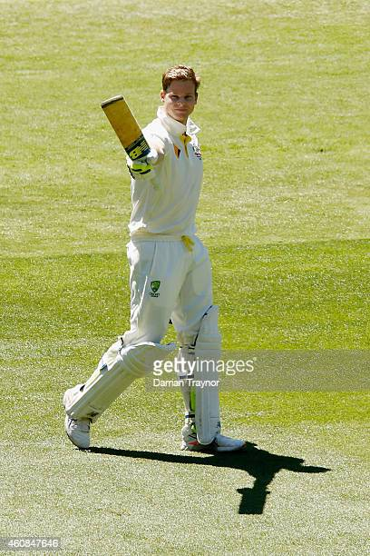 Steve Smith of Australia raises his bat after scoring 100 runs during day two of the Third Test match between Australia and India at Melbourne...