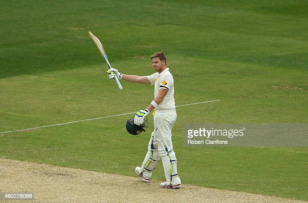 Steve Smith of Australia raises his bat after scoring 150 runs during day two of the First Test match between Australia and India at Adelaide Oval on...