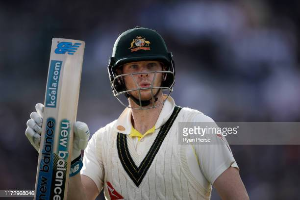 Steve Smith of Australia raises his bat as he leaves the ground after being dismissed for 82 runs during day four of the 4th Specsavers Test between...