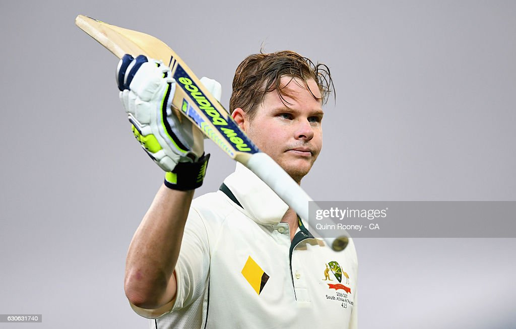 Steve Smith of Australia raises his bat to the crowd as he comes from the field during a rain delay after making his century during day four of the Second Test match between Australia and Pakistan at Melbourne Cricket Ground on December 29, 2016 in Melbourne, Australia.
