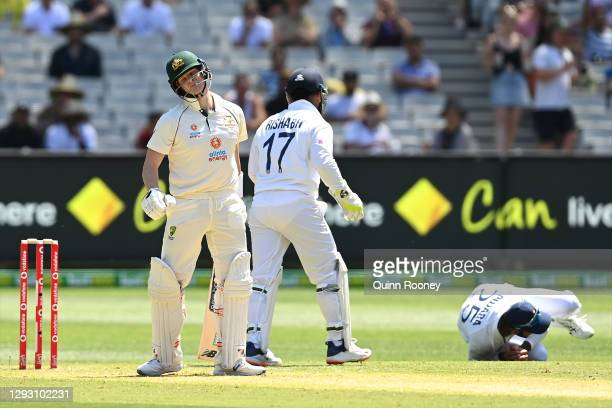 Steve Smith of Australia reacts after being caught by Cheteshwar Pujara of India during day one of the Second Test match between Australia and India...