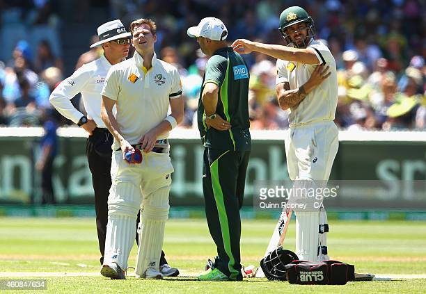 Steve Smith of Australia reacts after being hit in the groin during day two of the Third Test match between Australia and India at Melbourne Cricket...