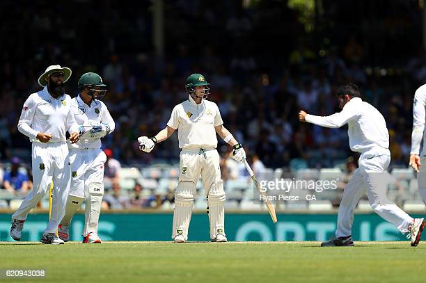 Steve Smith of Australia reacts after he was given out LBW off the bowling of Keshav Maharaj of South Africa during day two of the First Test match...