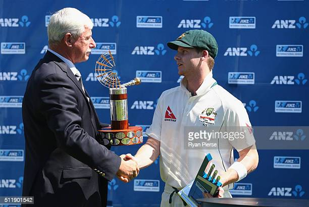 Steve Smith of Australia recieves the Trans Tasman Trophy from Sir Richard Hadlee during day five of the Test match between New Zealand and Australia...