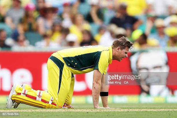 Steve Smith of Australia shows discomfort after being hit in the groin by the ball during game two of the One Day International series between...