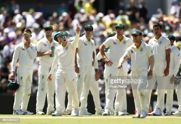Steve Smith of Australia signals to Mark Stoneman of England after he began to walk back to the middle after being dismissed by Mitchell Starc of...