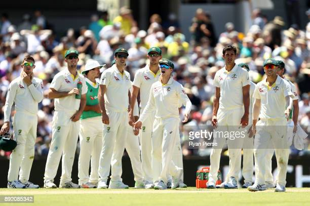 Steve Smith of Australia signals to Umpire Marais Erasmus after Mark Stoneman of England began to walk back to the middle after being dismissed by...