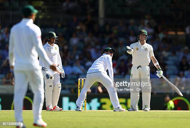 Steve Smith of Australia speaks to Faf du Plessis of South Africa after Dean Elgar of South Africa after having words with Dean Elgar of South Africa...