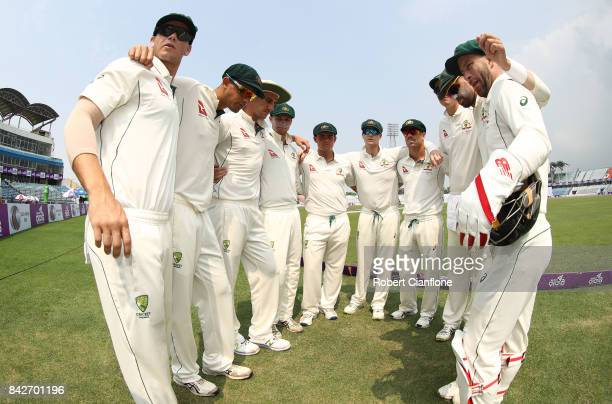Steve Smith of Australia speaks to the players as they prepare to enter the field during day two of the Second Test match between Bangladesh and...
