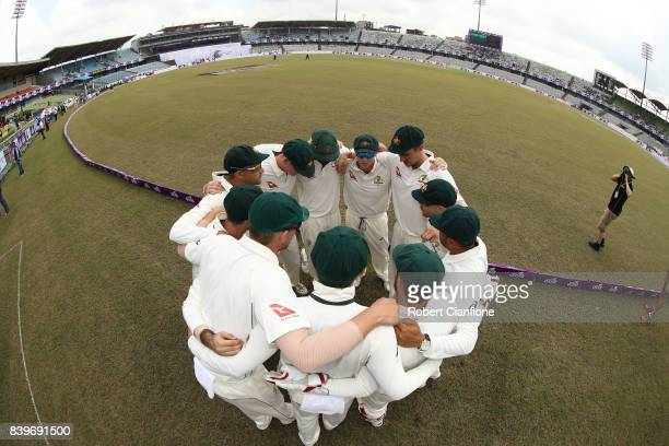 Steve Smith of Australia speaks to the team as they prepare to enter the field during day one of the First Test match between Bangladesh and...