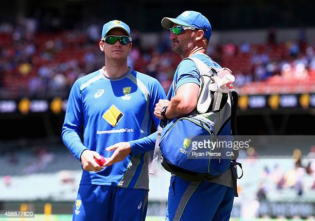 Steve Smith of Australia speaks with Australian Batting Coach Michael DiVenuto during day one of the Third Test match between Australia and New...