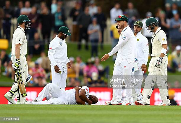 Steve Smith of Australia speaks with Faf du Plessis of South Africa after he collided with Vernon Philander of South Africa during day one of the...