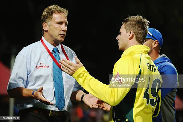 Steve Smith of Australia speaks with match referee Chris Broad after a controversial decision which dismissed Mitchell Marsh of Australia during the...