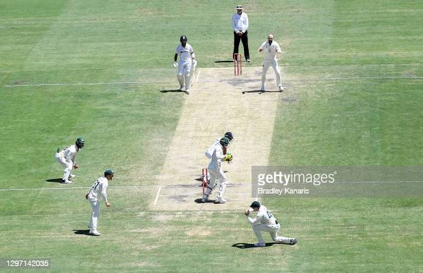 Steve Smith of Australia takes a catch off of the bowling of Nathan Lyon to take the wicket of Shubman Gill of India during day five of the 4th Test...