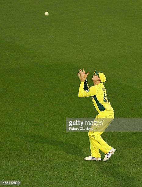 Steve Smith of Australia takes a catch to dismiss Chris Woakes of England during the 2015 ICC Cricket World Cup match between England and Australia...