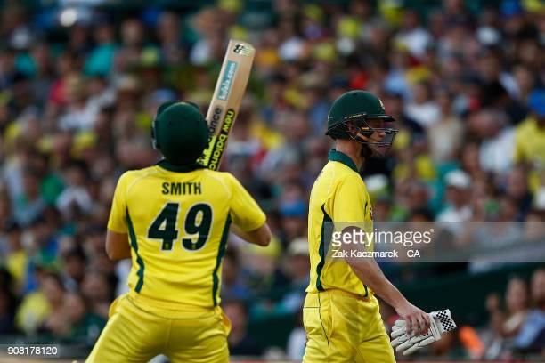Steve Smith of Australia takes the field as Cameron White of Australia leaves the field of play after being dismissed by Mark Wood of England during...