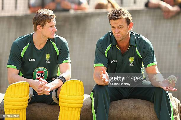 Steve Smith of Australia talks to Adam Gilchrist during an Australian nets session at Melbourne Cricket Ground on March 28 2015 in Melbourne Australia