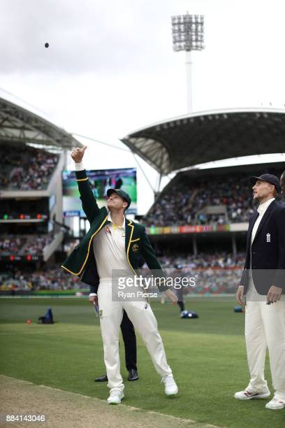 Steve Smith of Australia tosses the coin as Joe Root of England looks on during day one of the Second Test match during the 2017/18 Ashes Series...