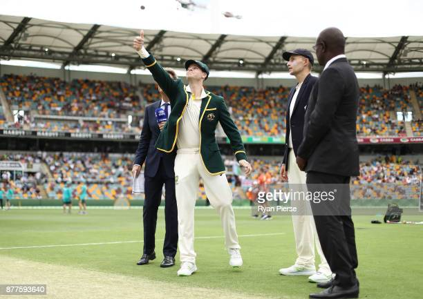 Steve Smith of Australia tosses the coin during day one of the First Test Match of the 2017/18 Ashes Series between Australia and England at The...