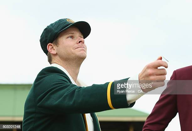 Steve Smith of Australia tosses the coin during day one of the third Test match between Australia and the West Indies at Sydney Cricket Ground on...