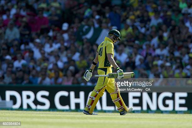 Steve Smith of Australia walks back to the pavilion after being dismissed by Hassan Ali of Pakistan during game four of the One Day International...
