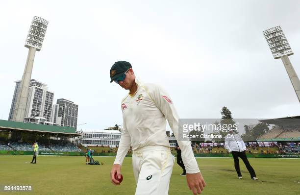 Steve Smith of Australia walks off the ground as rain falls during day five of the Third Test match during the 2017/18 Ashes Series between Australia...