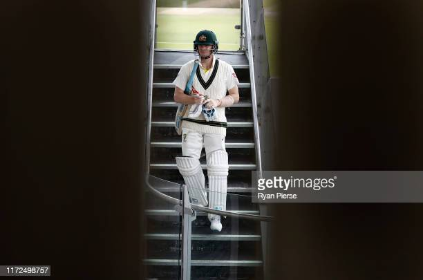 Steve Smith of Australia walks out to bat after lunch on 101 not out during day two of the 4th Specsavers Test between England and Australia at Old...
