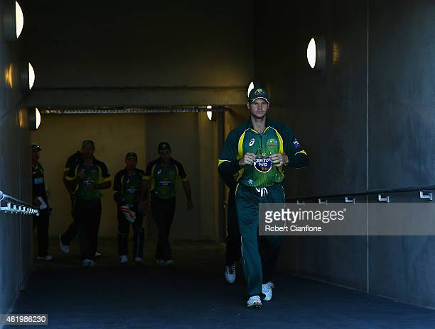 Steve Smith of Australia walks out to field prior to the One Day International Tri Series match between Australia and England at Blundstone Arena on...