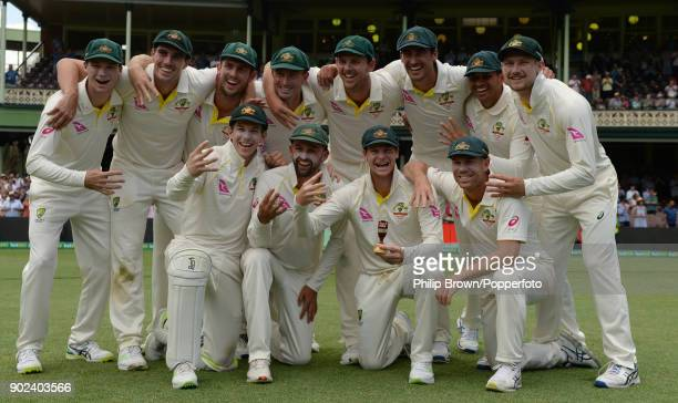 Steve Smith of Australia with a replica of the Ashes urn and his team after the fifth Ashes cricket test match between Australia and England at the...