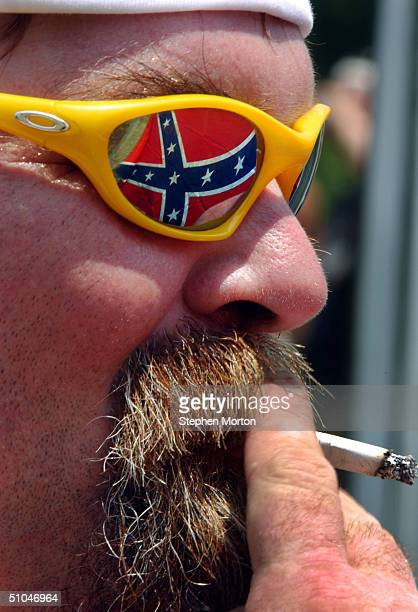 Steve Smith of Raleigh North Carolina smokes a cigarette while waiting for the first event of the 9th Annual Summer Redneck Games July 10 2004 in...