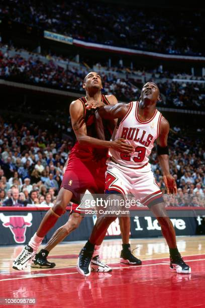 Steve Smith of the Atlanta Hawks is seen on guard against Michael Jordan of the Chicago Bulls during the game between the Atlanta Hawks and the...