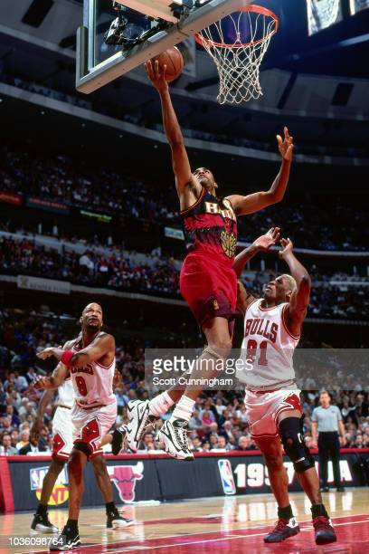 Steve Smith of the Atlanta Hawks shoots the ball during the game against the Chicago Bulls on May 8 1997 at the United Center in Chicago IL NOTE TO...