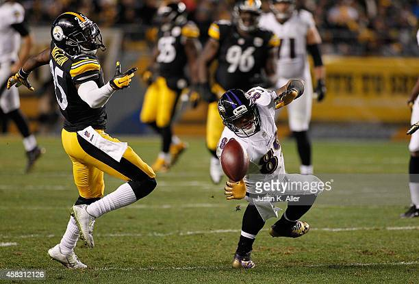 Steve Smith of the Baltimore Ravens can't pull in a catch in front of Brice McCain of the Pittsburgh Steelers during the third quarter at Heinz Field...