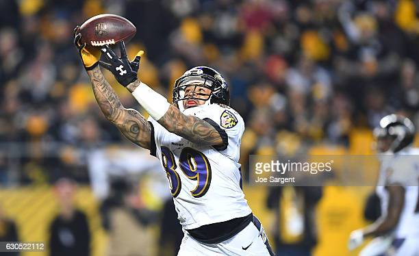 Steve Smith of the Baltimore Ravens catches a pass from Joe Flacco for an 18 yard touchdown reception in the third quarter during the game against...