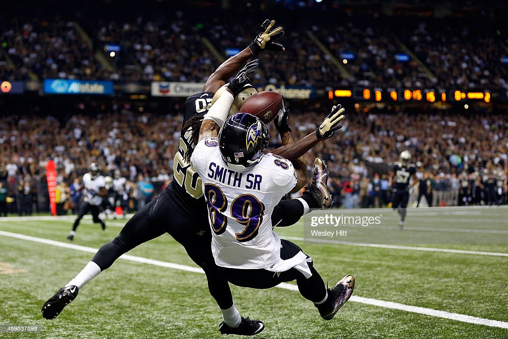 Steve Smith #89 of the Baltimore Ravens catches a touchdown pass in front of Brian Dixon #20 of the New Orleans Saints during the first quarter of a game at the Mercedes-Benz Superdome on November 24, 2014 in New Orleans, Louisiana.