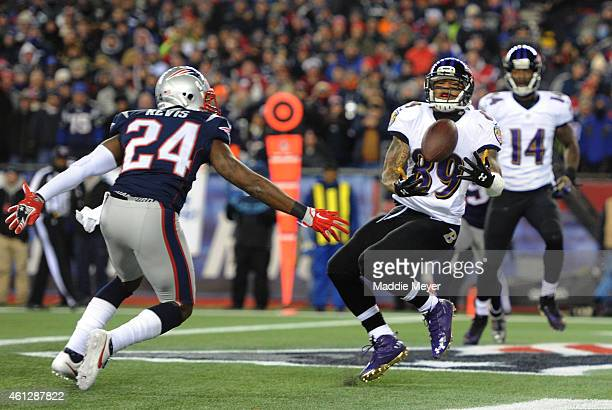 Steve Smith of the Baltimore Ravens catches a touchdown pass in the first quarter against Darrelle Revis of the New England Patriots during the 2014...